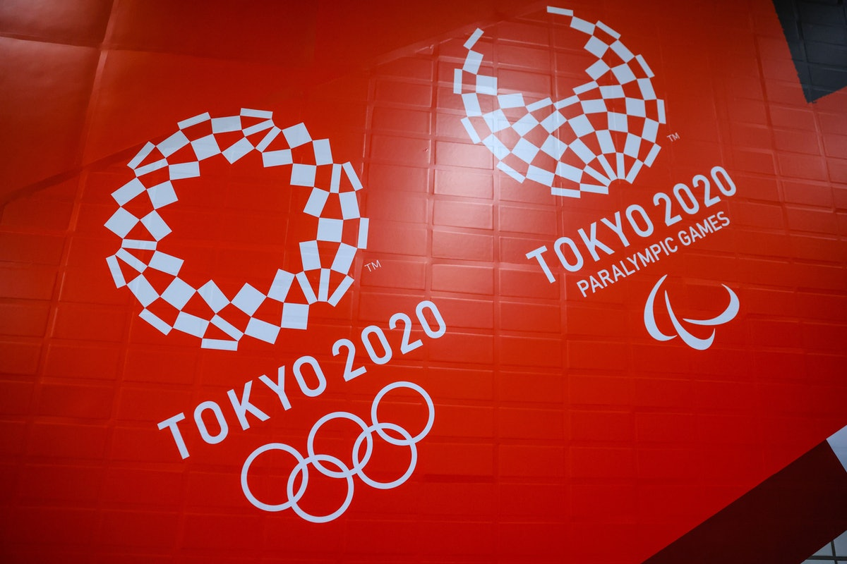 TOKYO, JAPAN - 2021/06/25: Tokyo 2020 Olympic and Paralympic Games branding inside a subway station ...