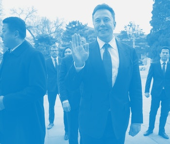 BEIJING, CHINA - JANUARY 09: Tesla CEO Elon Musk, center, waves as he waits for a meeting with Chine...
