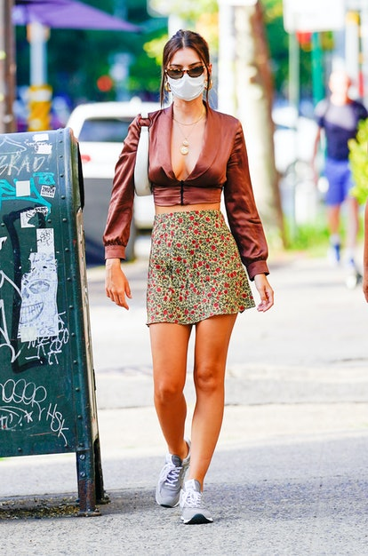 Model and street style star Emily Ratajkowski wears Réalisation Par Cookies skirt on July 31, 2020 i...