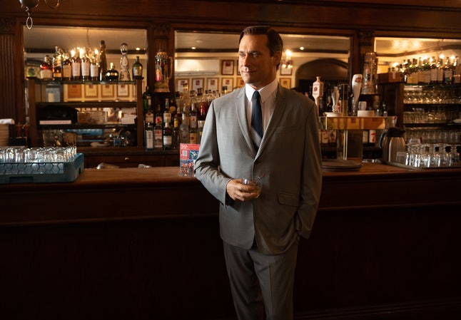 NEW YORK, NEW YORK - FEBRUARY 24: Madame Tussauds Jon Hamm wax figure holds a glass of whiskey by th...
