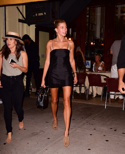 Model Hailey Baldwin leaves Cipriani Downtown in New York City while wearing a black Christy dress f...