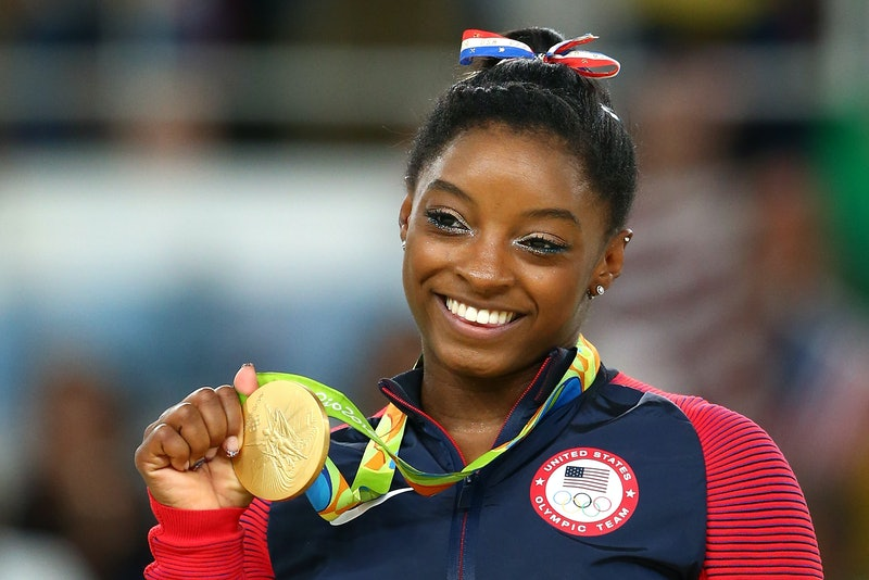 Simone Biles shows off a gold medal at the summer olympics in 2016. How much are olympic medals wort...