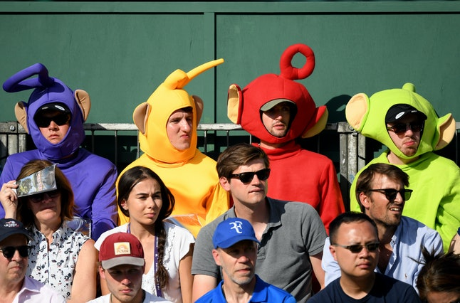 LONDON, ENGLAND - JULY 02: Spectators dressed as the Teletubbies looks on from the stand during Day ...