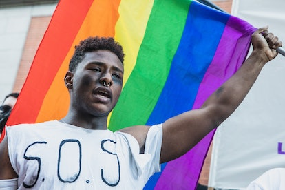 MADRID, SPAIN - JULY 05: Protestor holds a rainbow flag during the demonstration for Samuel's Luiz d...
