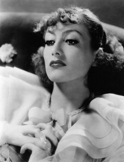 Joan Crawford's wispy bangs of the 1930s mark a departure from the previous decade's style.