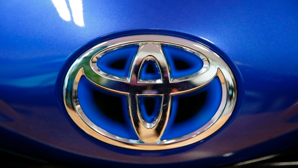 The Toyota company logo is seen on a Yaris model car that is on display at Toyota's automobile manuf...