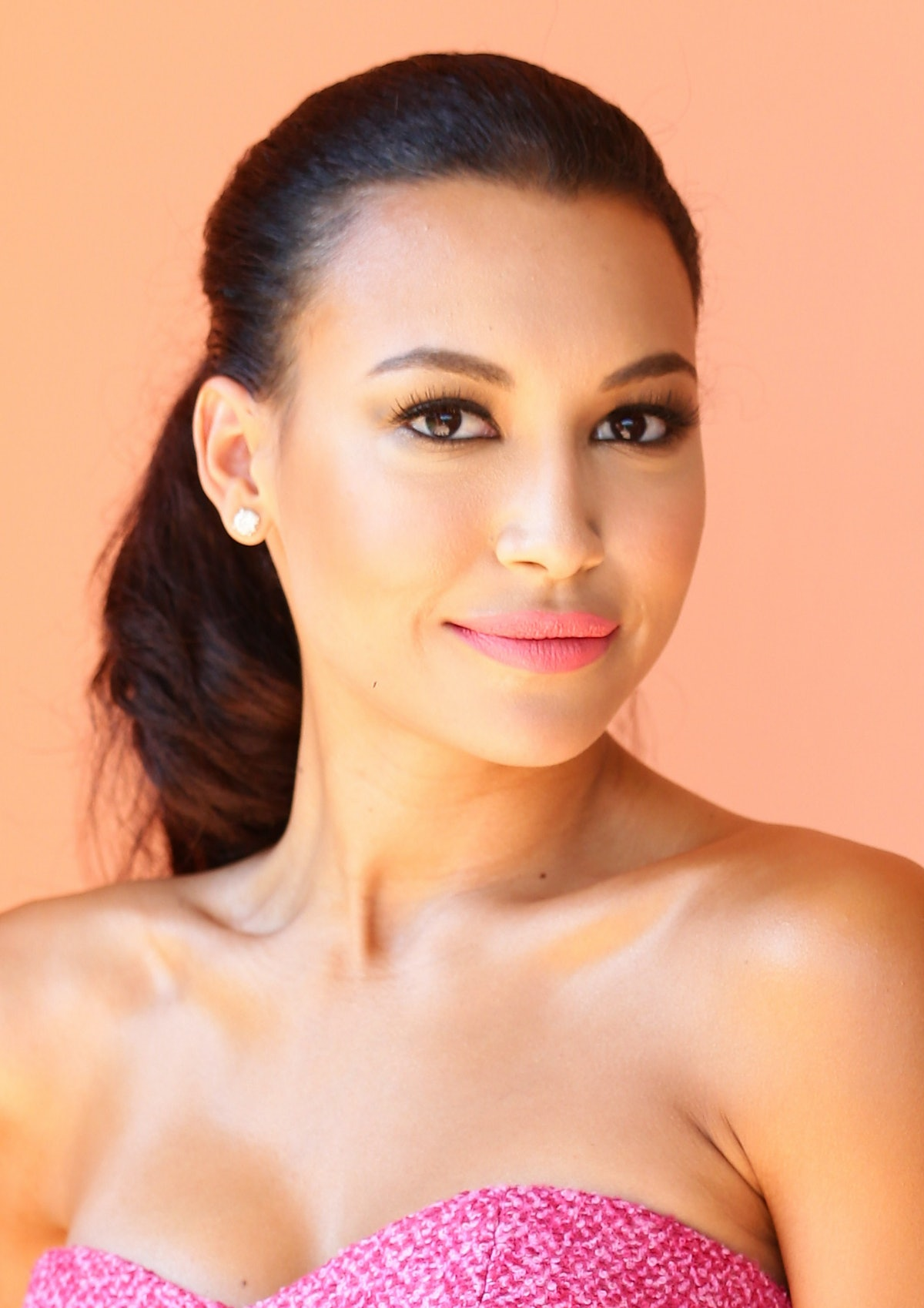 Naya Rivera, shown here in pink lipstick and a ponytail, will be missed by her 'Glee' co-stars.