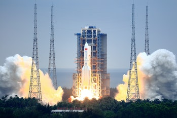 WENCHANG, CHINA - APRIL 29: A Long March-5B Y2 rocket carrying the core module of China's space stat...