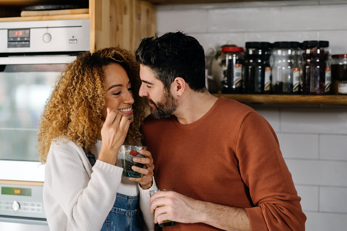 A young interracial couple kissing but hoping to avoid beard burn from a scruffy beard