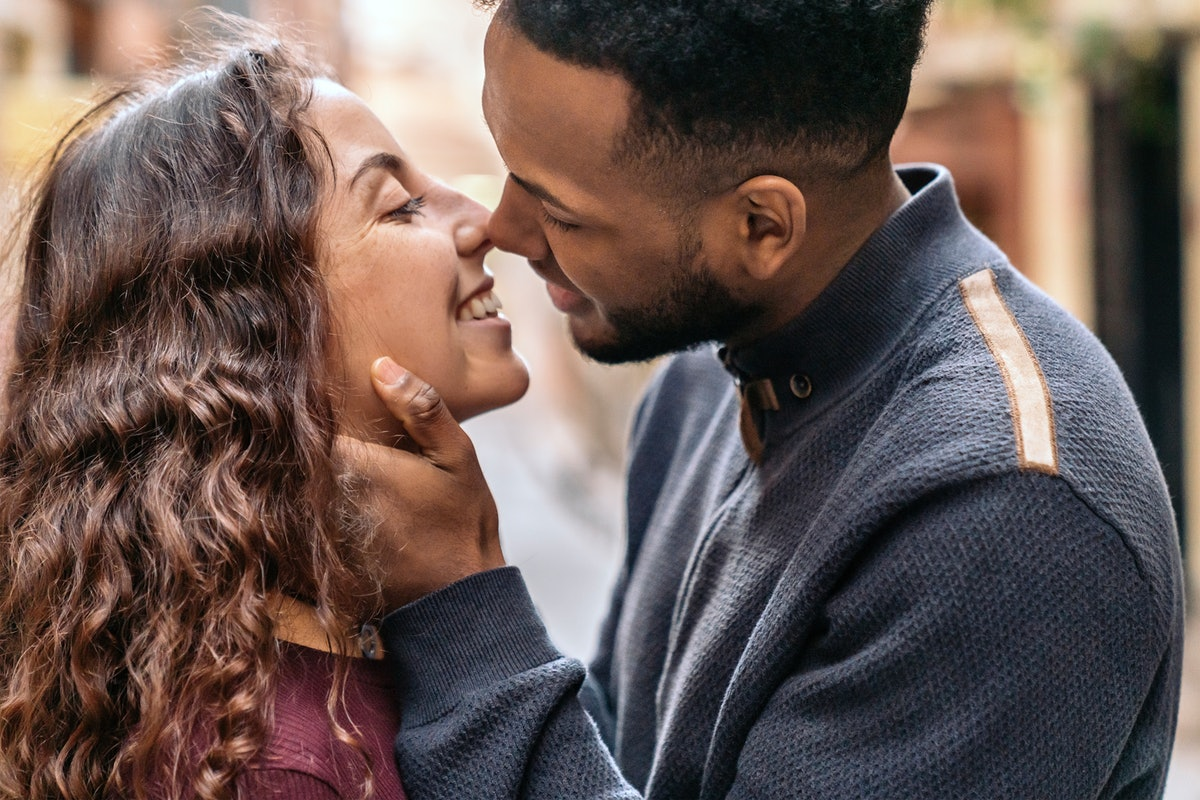 A photo of a young woman about to kiss a man with a beard, which can cause beard burn after kissing