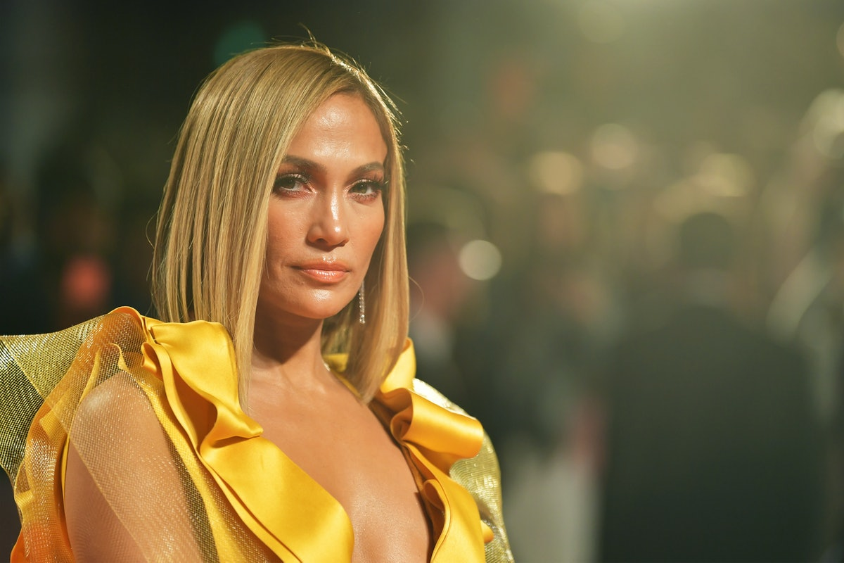 Jennifer Lopez, shown here at an event in a gold gown, is living her best life, as seen in her new m...