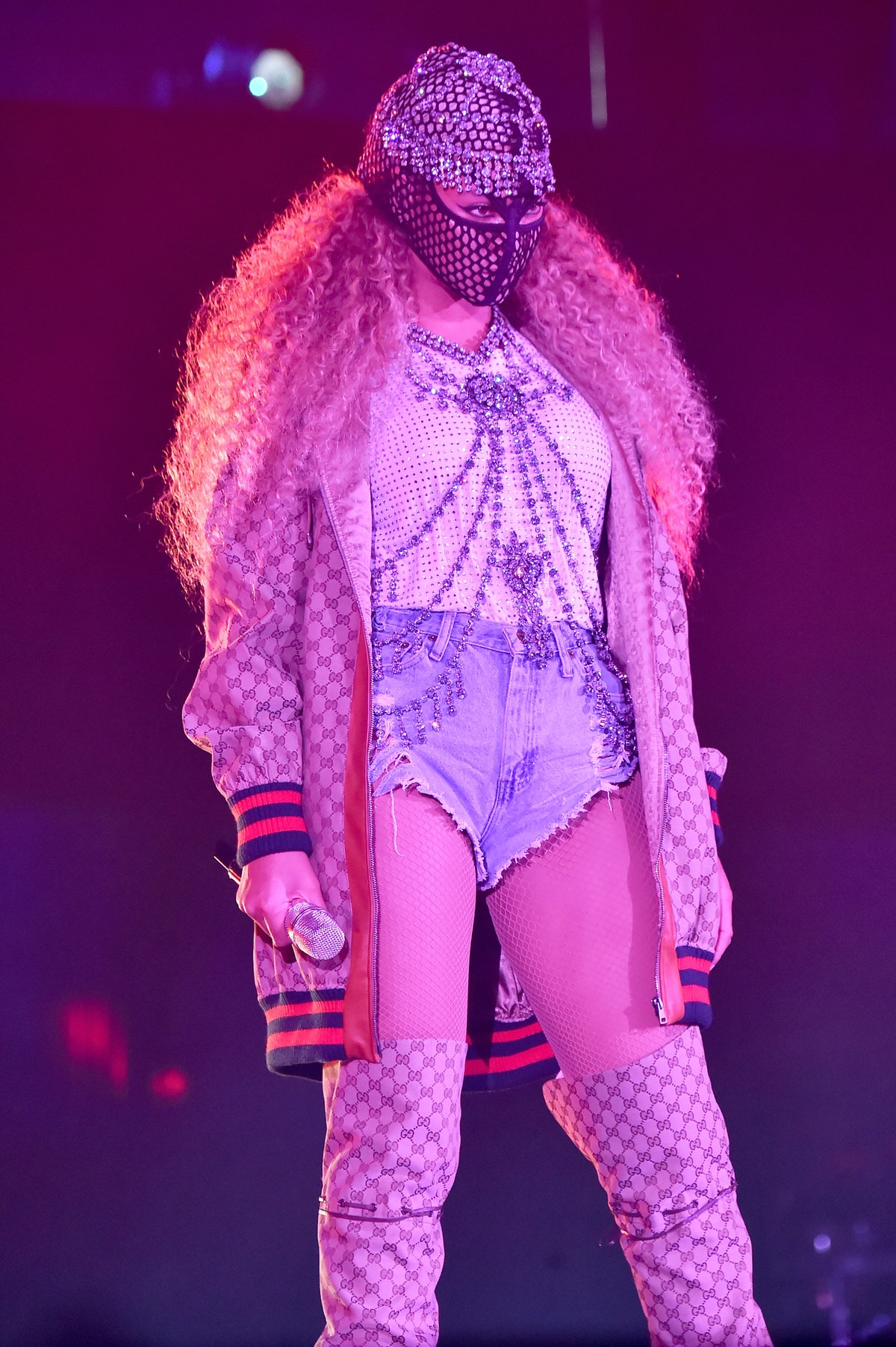 Beyonce Knowles performs in a mask, bejeweller corset, and Gucci jacket on June 6, 2018 in Cardiff, ...