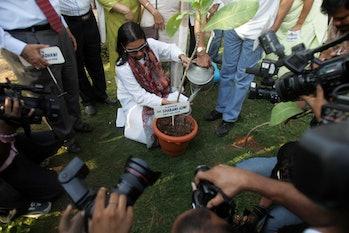 MUMBAI, INDIA - APRIL 14, 2008: Shabana Azmi inaugurates the park on Juhu Beach by planting a tree. ...