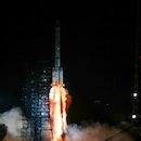 LIANGSHAN, CHINA - AUGUST 06: A Long March-3B carrier rocket carrying Zhongxing-2E satellite blasts ...
