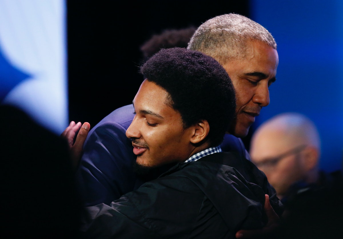 Former President Barack Obama hugs a young man following his town hall conversation at the My Brothe...