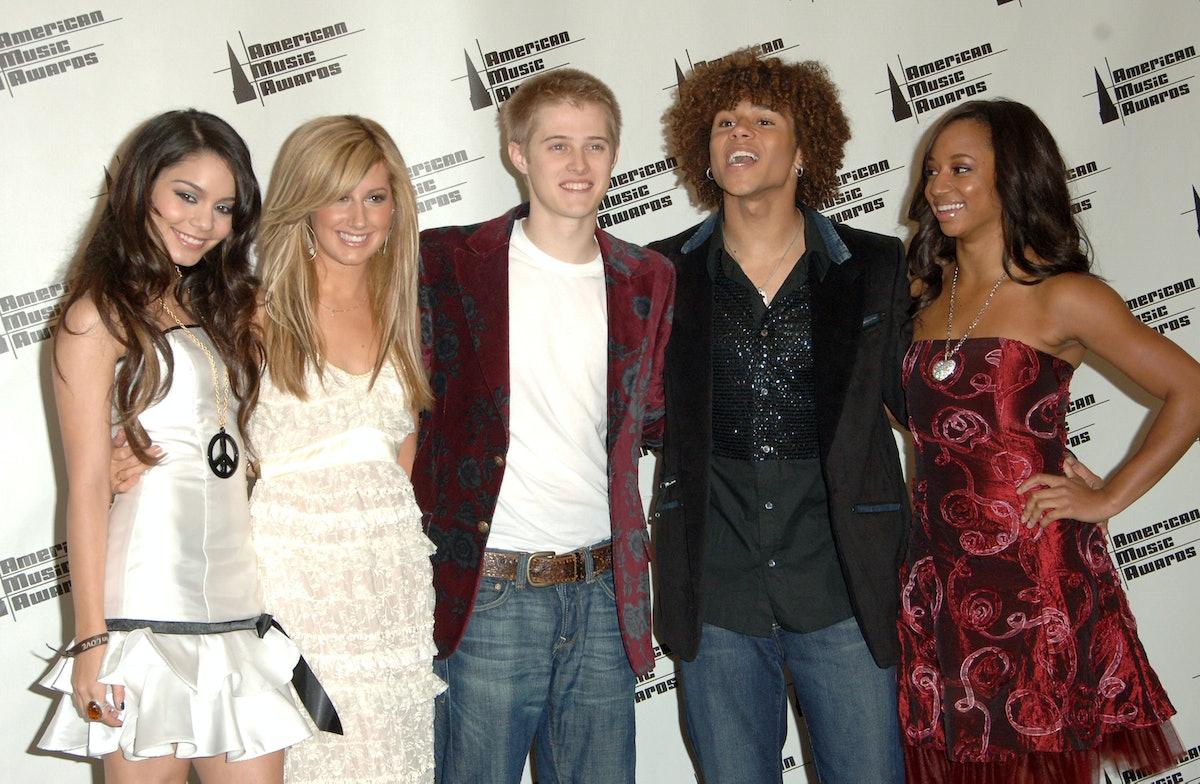 Ashley Tisdale in 2006, standing alongside her High School Musical castmates.