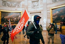 WASHINGTON, DC - JANUARY 06: Protesters gather storm the Capitol and halt a joint session of the 117...