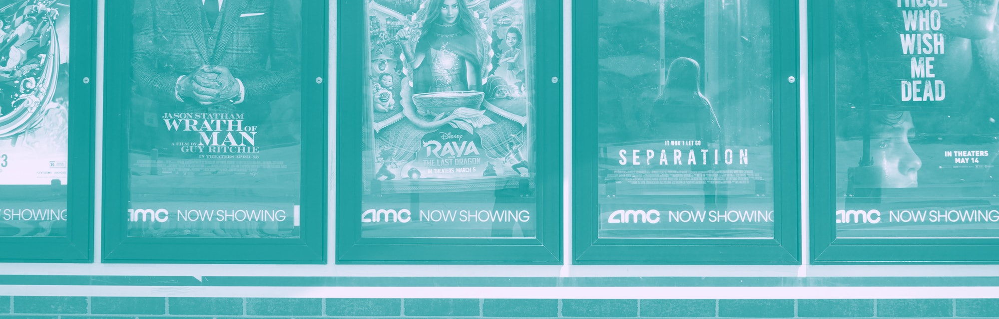 CHICAGO, ILLINOIS - JUNE 01: Movie poster of current offerings are displayed on the front of an AMC ...