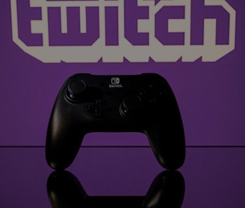 A gamepad is pictured as a screen displays the online Twitch plateform in Toulouse, southwestern Fra...