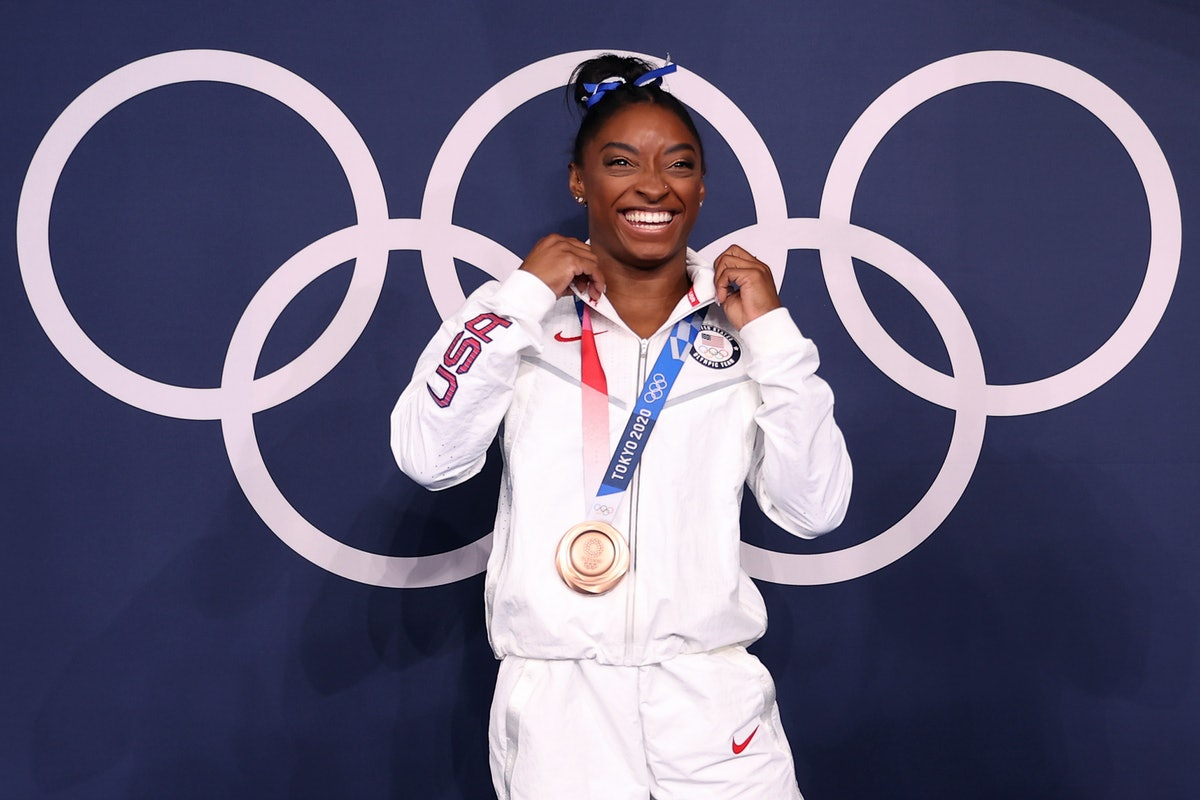 Simone Biles of Team United States poses with the bronze medal following the Women's Balance Beam Fi...