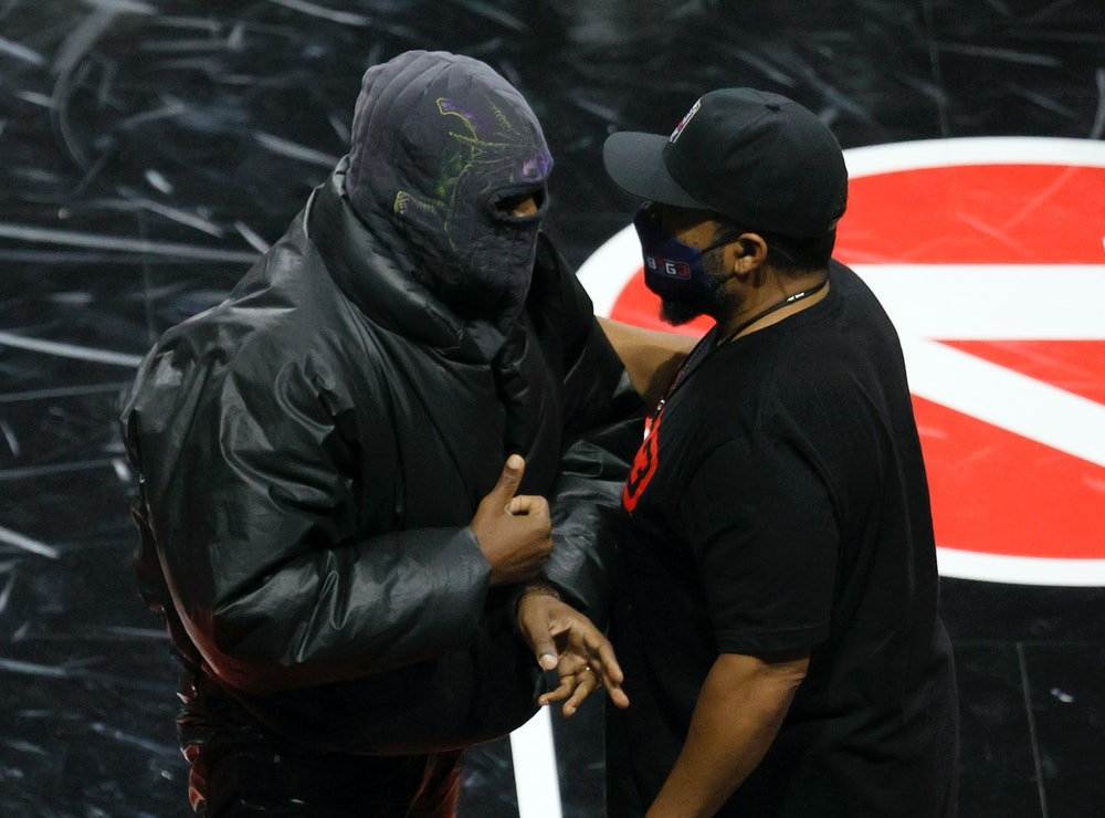 LAS VEGAS, NEVADA - JULY 17:  Rapper Kanye West (L) and BIG3 Co-Founder Ice Cube talk after a game b...