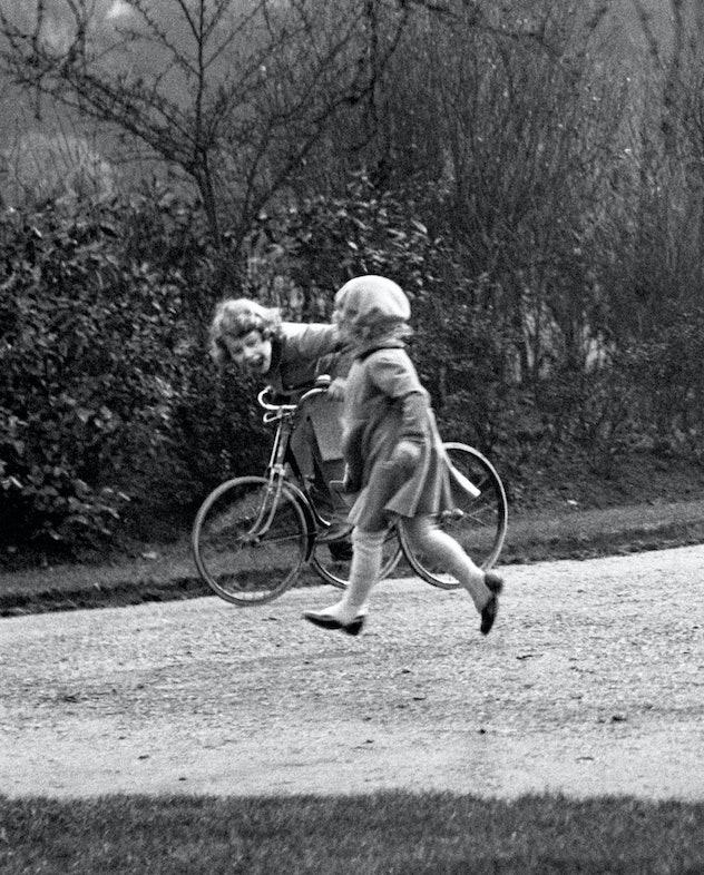 Princess Elizabeth riding a tricycle.