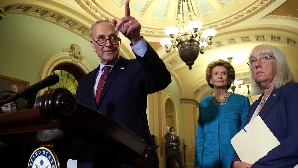 WASHINGTON, DC - JULY 20:  U.S. Senate Majority Leader Sen. Chuck Schumer (D-NY) (L) takes questions...
