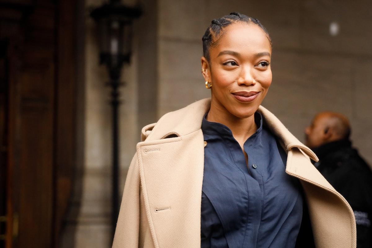 PARIS, FRANCE - MARCH 02: Naomi Ackie wearing Stella McCartney trench coat, navy shirt green stilett...
