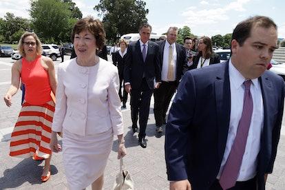 WASHINGTON, DC - JUNE 24:  (L-R) U.S. Sen. Kyrsten Sinema (D-AZ), Sen. Susan Collins (R-ME), Sen. Je...