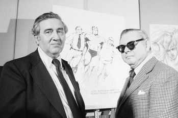 Superman creators Jerry Siegel and Joe Shuster pose in front of sketches of their creation. The pair...
