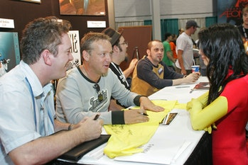 Artist Mike Perkin, Paul Jenkins, Ed Brubaker and Michael Lark at the Marvel booth (Photo by Barry B...
