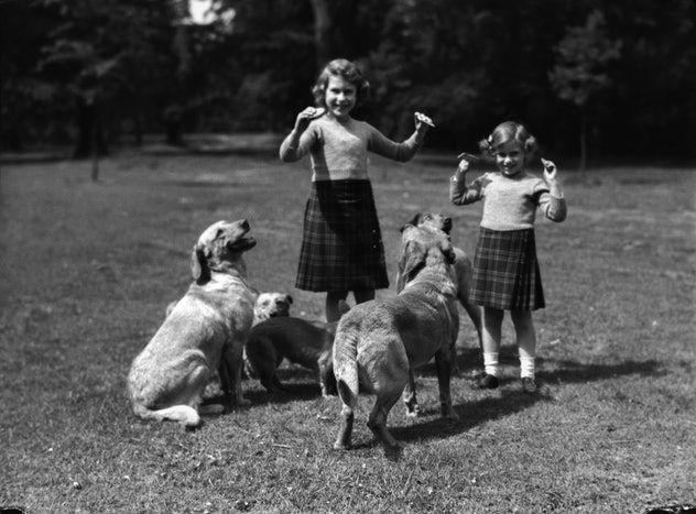 Princesses Elizabeth and Margaret with their dogs.