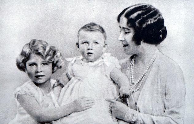 Princess Elizabeth looks so proud of sister Princess Margaret.