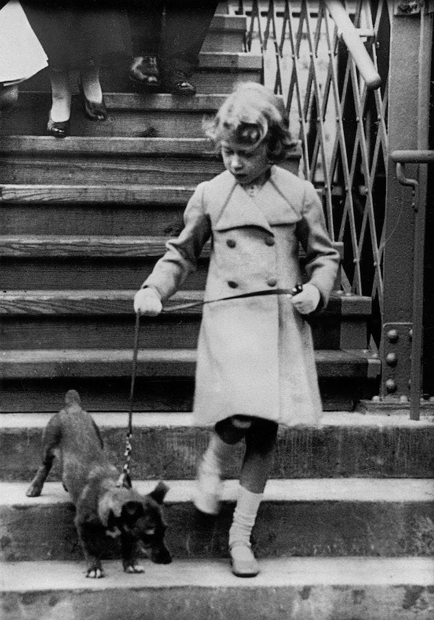 Princess Elizabeth walks her dog.
