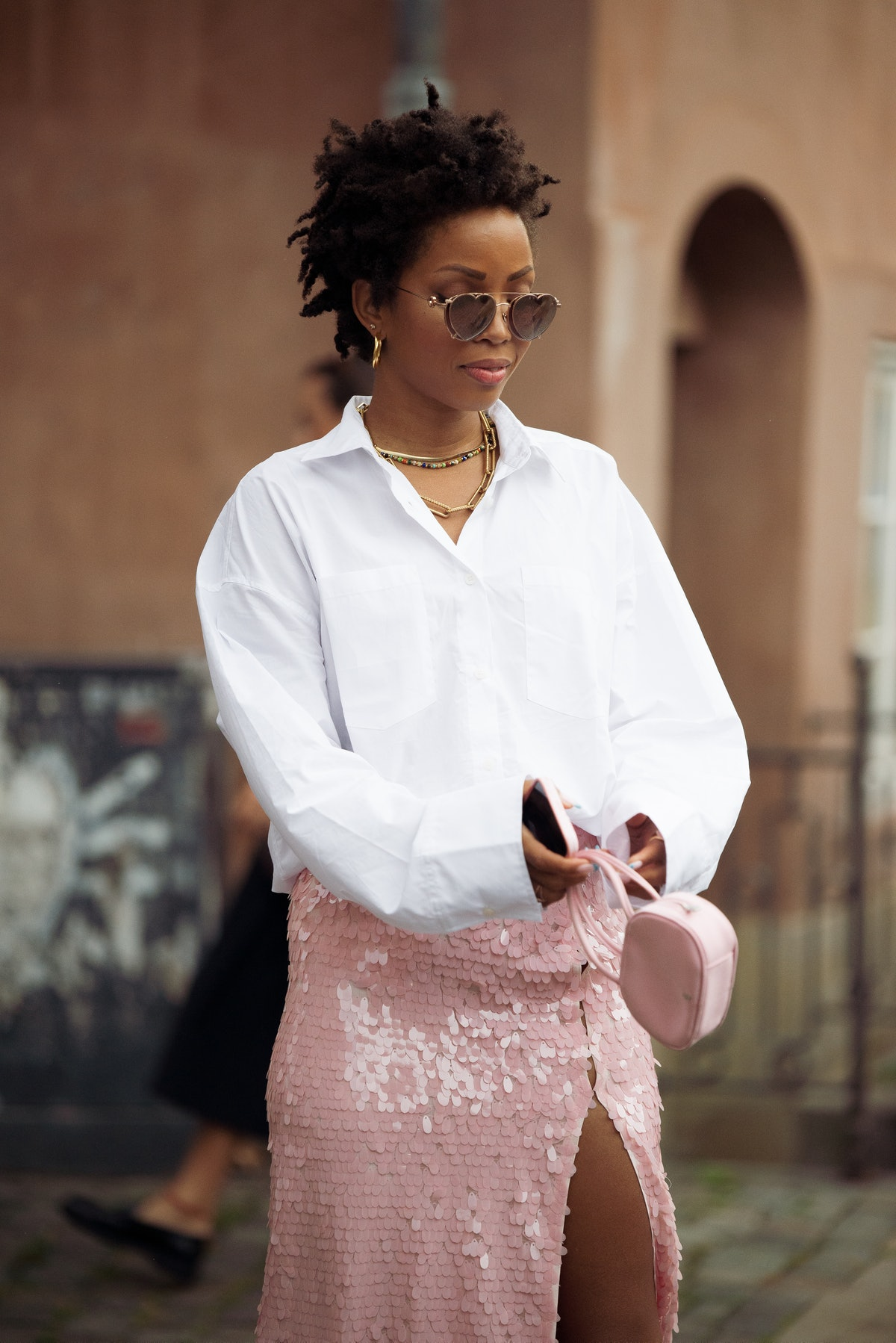 COPENHAGEN, DENMARK - AUGUST 10: Elizabeth Delphine wearing white shirt and pink skirt with pink min...
