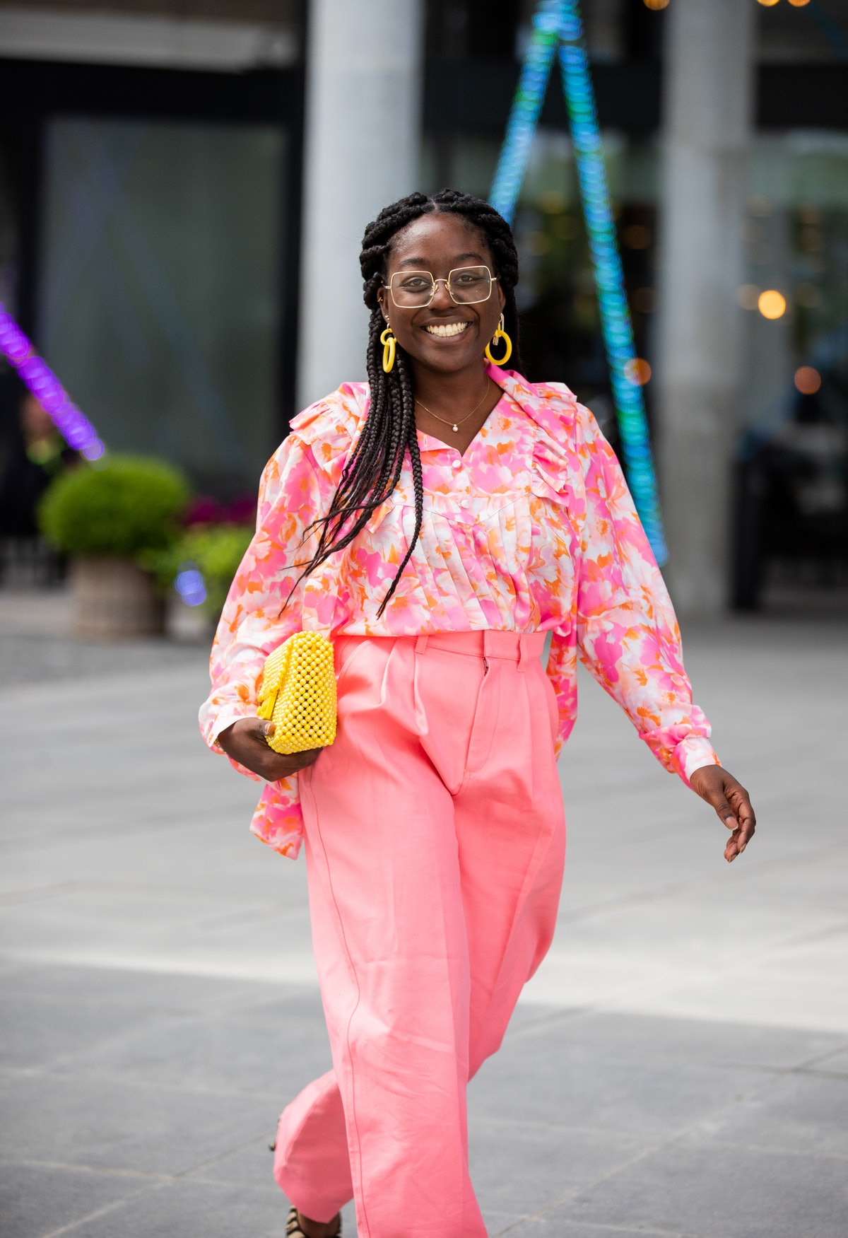 COPENHAGEN, DENMARK - AUGUST 11: Lois Opoku seen wearing pink pants, yellow Chanel bag outside Brøgg...