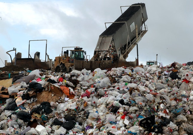 A San Francisco Recology truck drops about 20 tons of trash at the Waste Management landfill in Live...