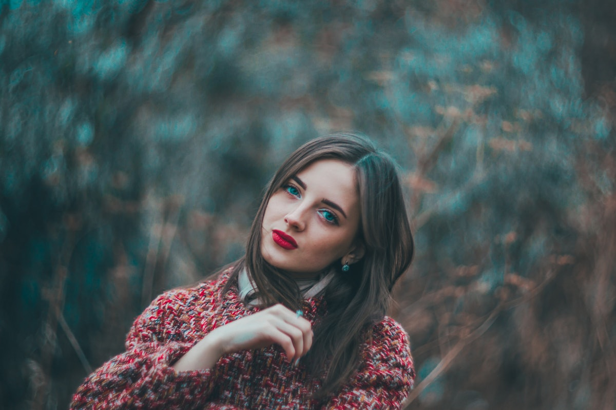 Young woman in a red shirt during the September 2021 new moon in Virgo, which will affect her zodiac...