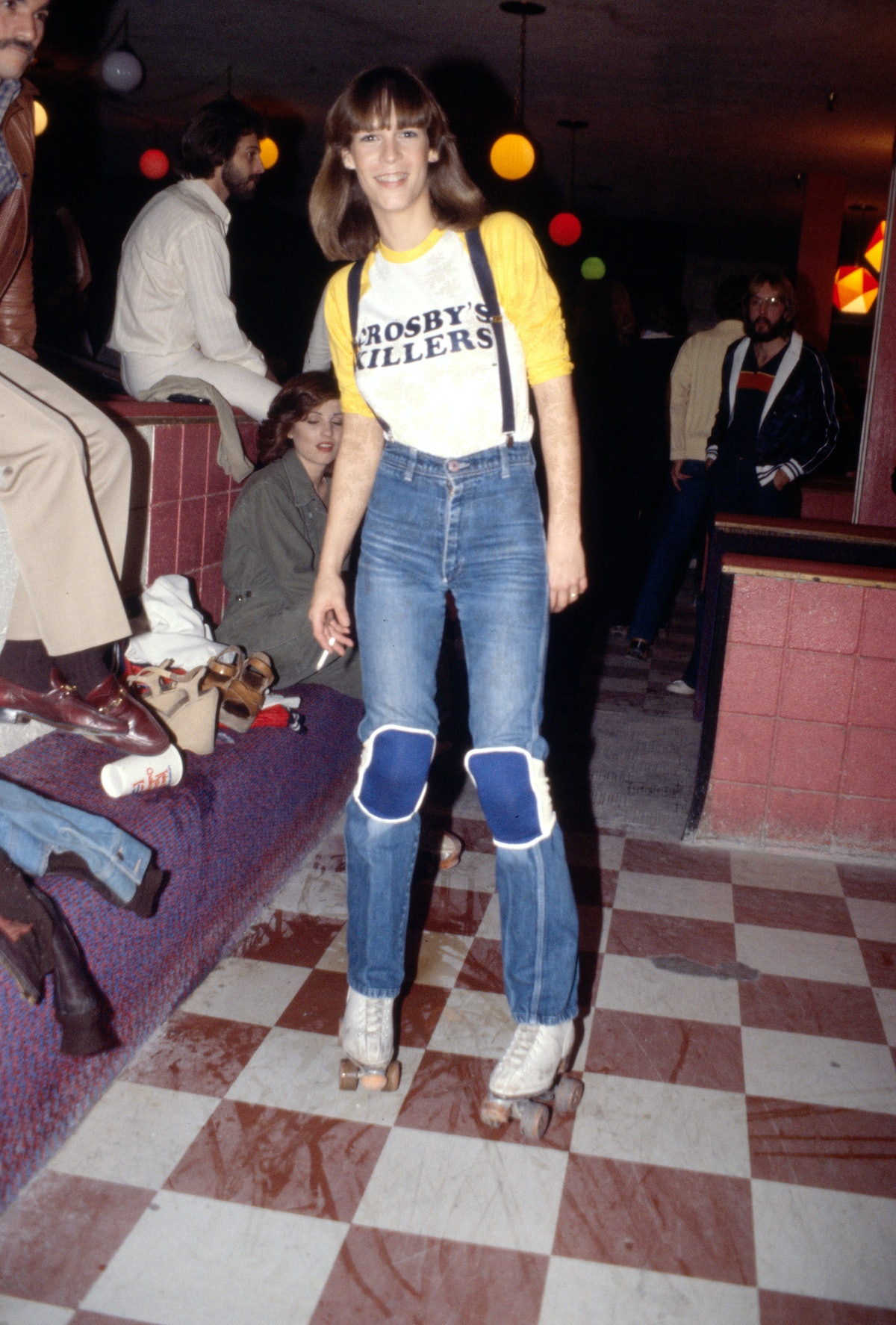 Jamie Lee Curtis, daughter of Janet Leigh and Tony Curtis, wears patchwork jeans, long-sleeve T-shir...