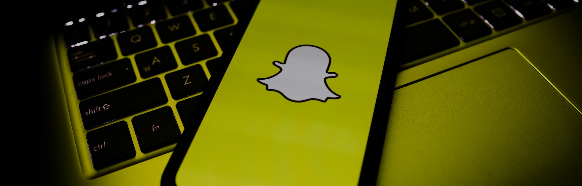 Snapchat logo is seen displayed on a phone screen in this illustration photo taken in Poland on Nove...