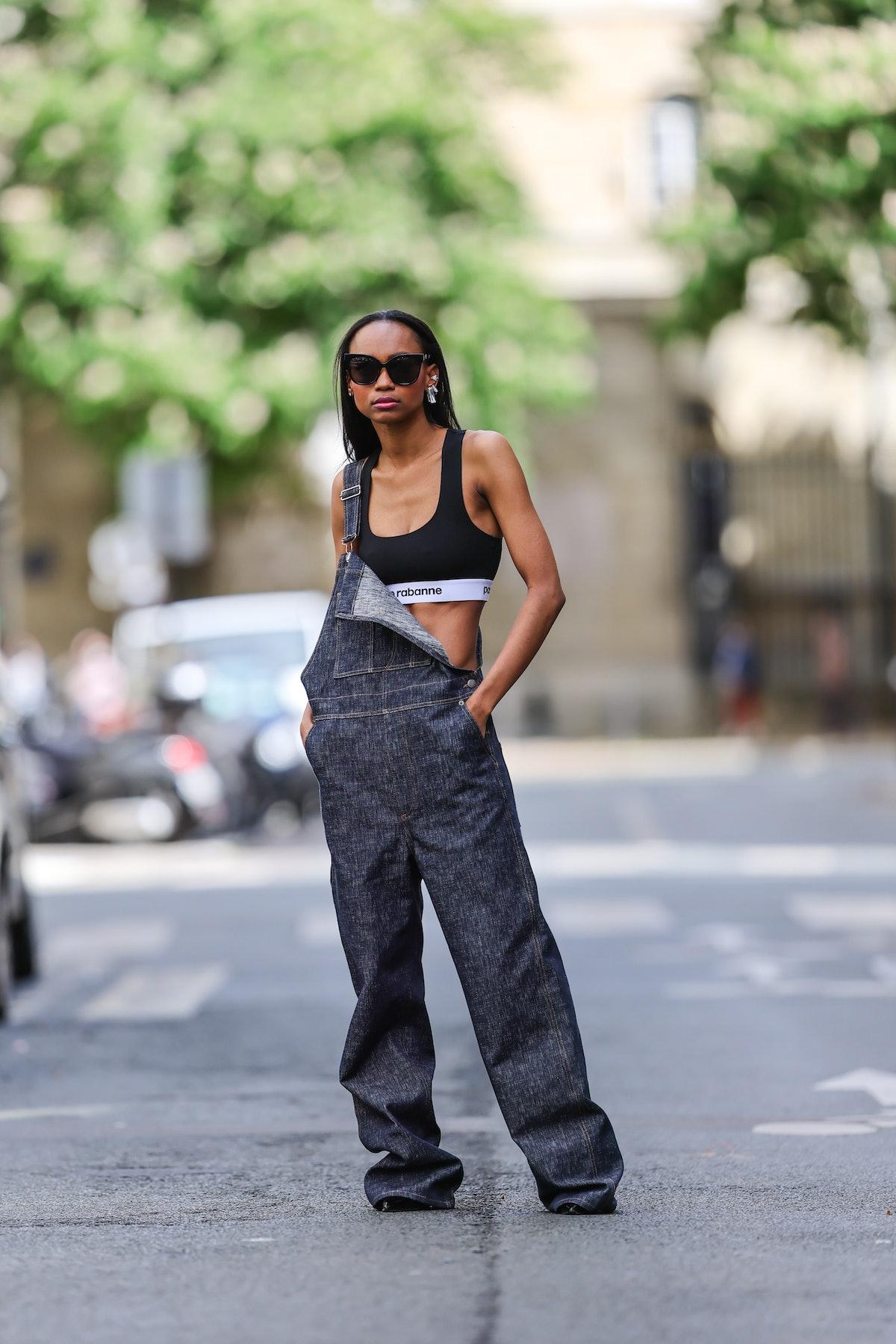 Emilie Joseph wears black vintage sunglasses, silver and crystal Swarovski Collection I by Giovanna ...