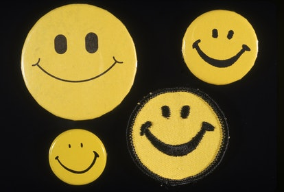 Four different Smiley face buttons, 1970s
