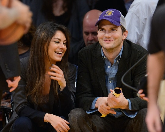 LOS ANGELES, CA - JANUARY 03:  Ashton Kutcher (R) and Mila Kunis attend a basketball game between th...