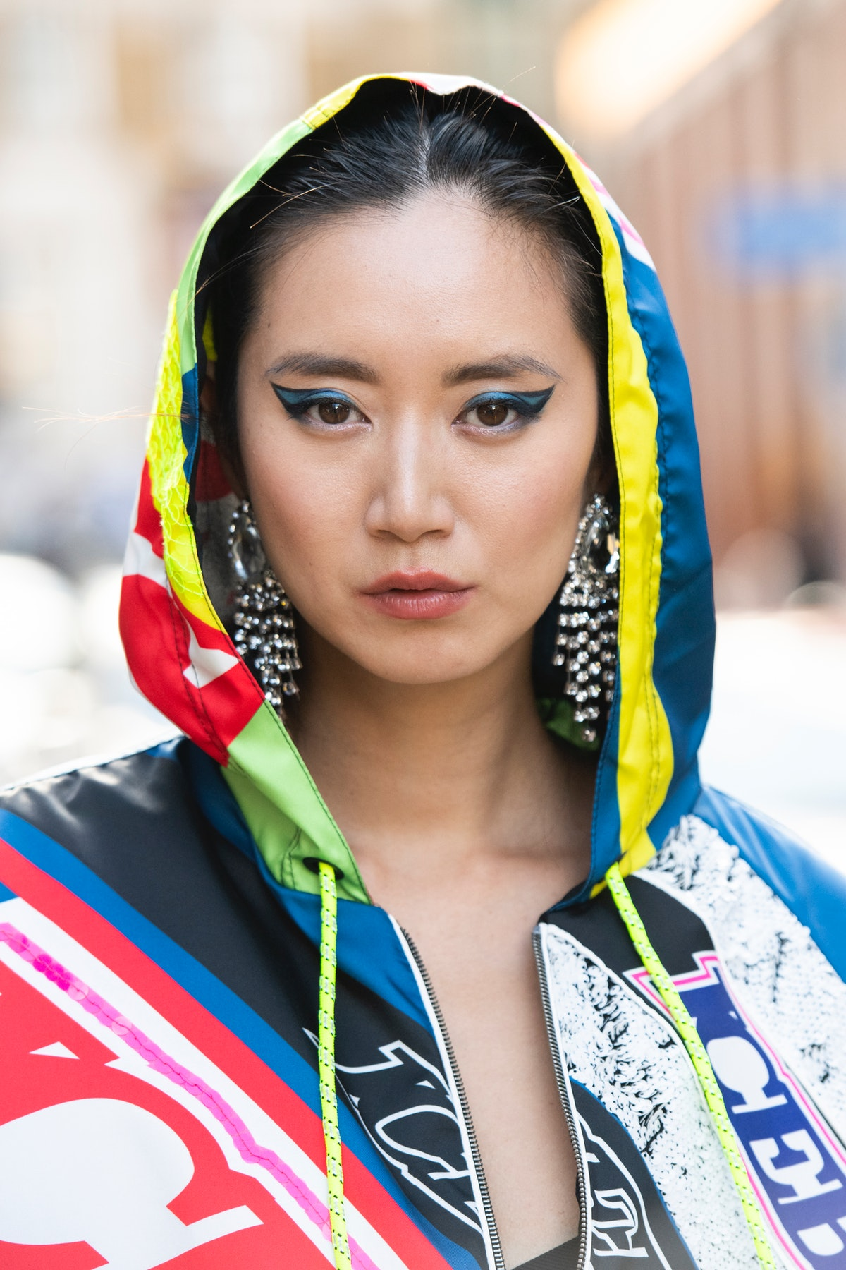 Betty Bachz wears blue and black graphic eyeliner and all Iceberg during London Fashion Week Men's J...