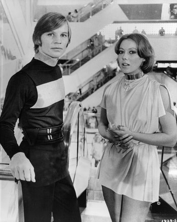 Michael York and Jenny Agutter ride an escalator in a scene from the film 'Logan's Run', 1976. (Phot...