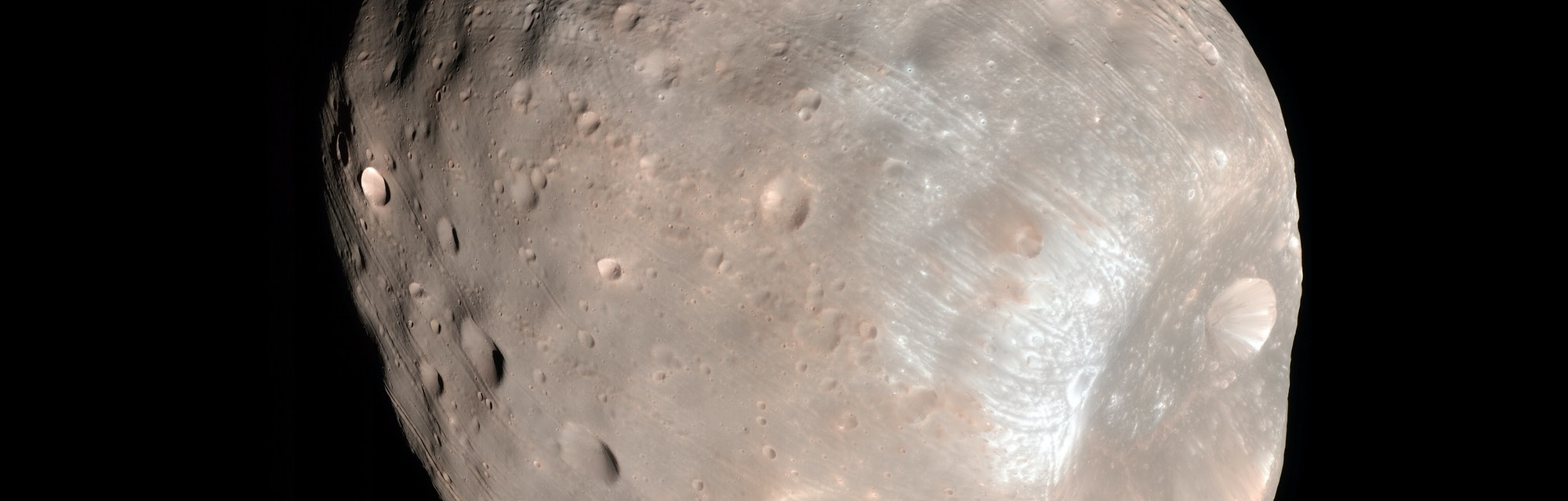 Enhanced-color image of Phobos from the Mars Reconnaissance Orbiter with Stickney crater on the righ...