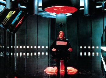 Michael York sits in a chair in a scene from the film 'Logan's Run', 1976. (Photo by Metro-Goldwyn-M...