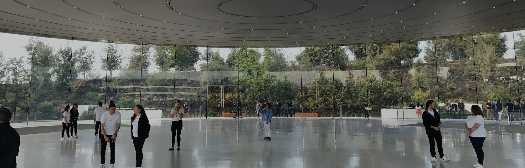 Tech journalists gather at the Steve Jobs Theater before the first-ever product launch at the new Ap...