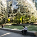 SEATTLE, WA - MAY 20: People use a common space outside of The Spheres at the Amazon.com Inc. headqu...