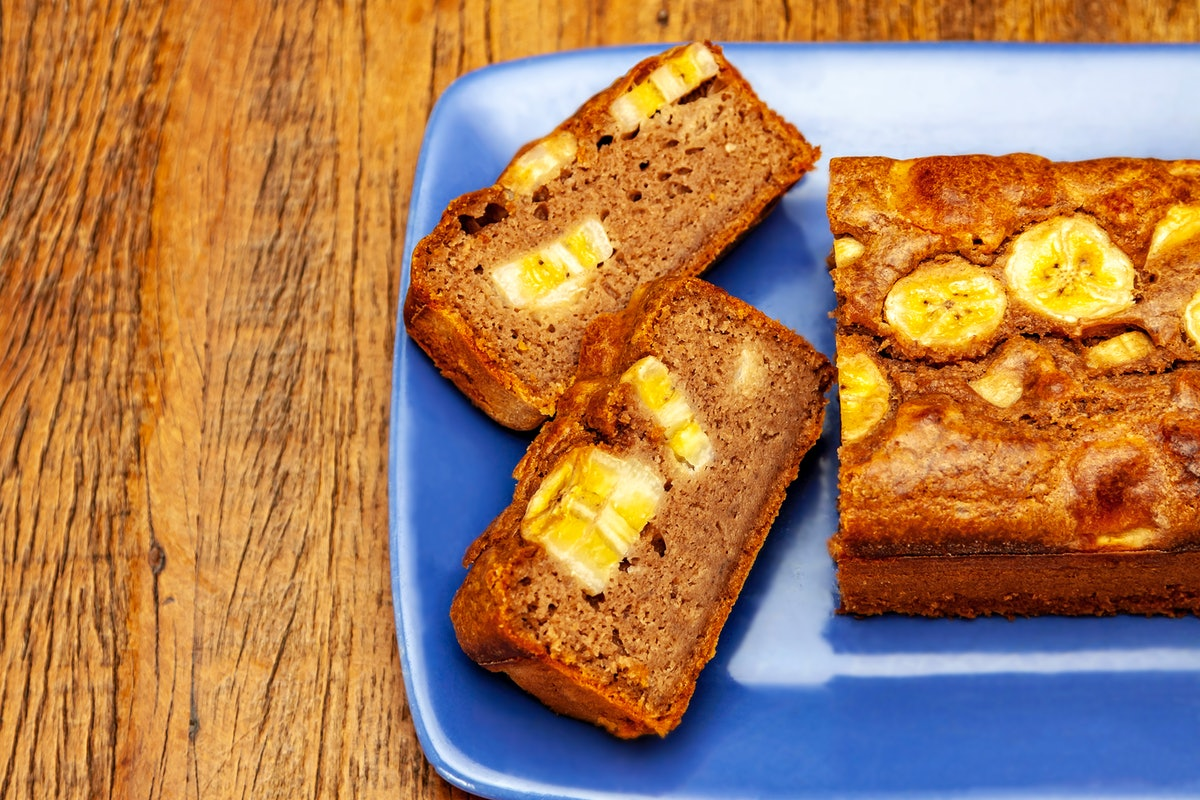 Two slices of banana bread on a blue plate, which you can make using these milk recipes.